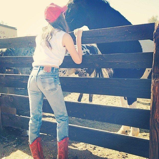 White tee, vintage denim, red cowboy boots
