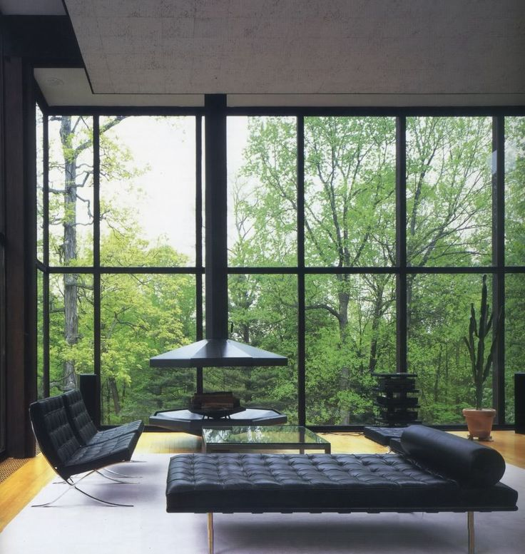 Clean, Masculine and Modern Room. Black Leather Barcelona Chaise and Chairs, and Suspended Fireplace, the Wiley House.