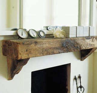 Railway sleeper used as mantlepiece - going for the distressed, rustic look
