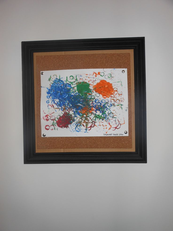 Actually, John made this. Just my idea. Frames made of wood trim, matted with corkboard to display kids' artwork.