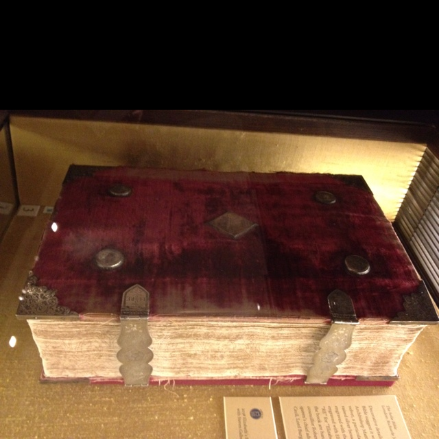 "Queen Elizabeth I's personal Bible. It has a red velvet covering with silver hardware engraved with the English Tudor rose and ""EL RE"" (Elizabeth Regina)."