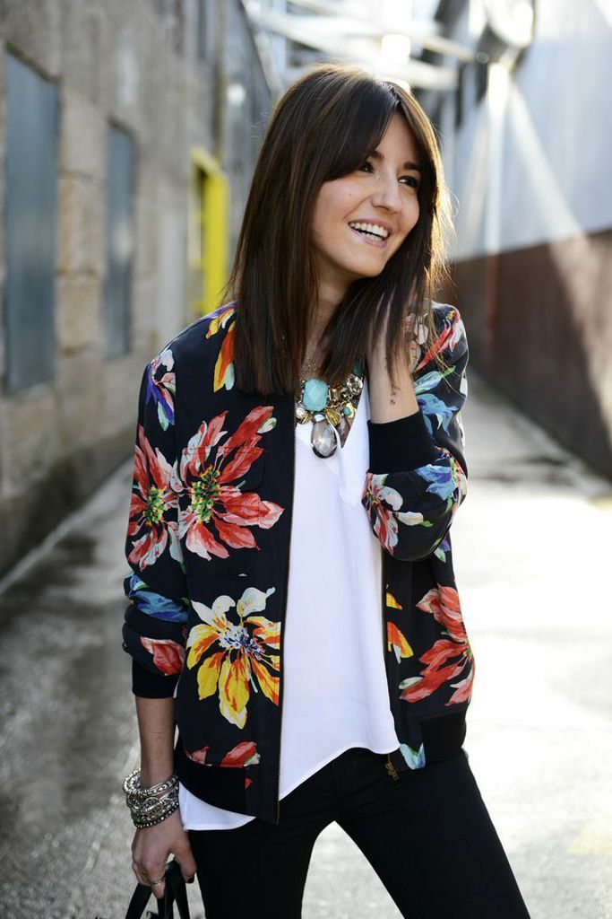 A floral printed bomber jacket is the perfect combination of feminine, sporty and edgy. Wear it with a statement necklace for a bit of glam.