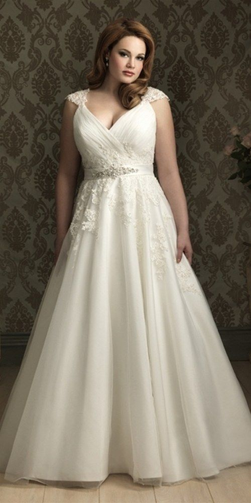romantic A-line plus size wedding gown featuring lace applque and tull