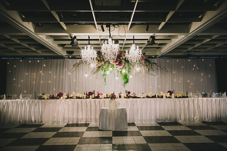Gorgeous Bridal Table with Hanging Florals and Chandeliers - Doltone House Darling Island Wharf www.doltonehouse.com.au #chandeliers #weddings #flowers #starcloth #pretty #floral #bridal #styling #hangingflorals