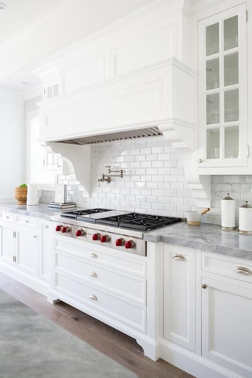 Stunning white cooktop designed with a white wood …