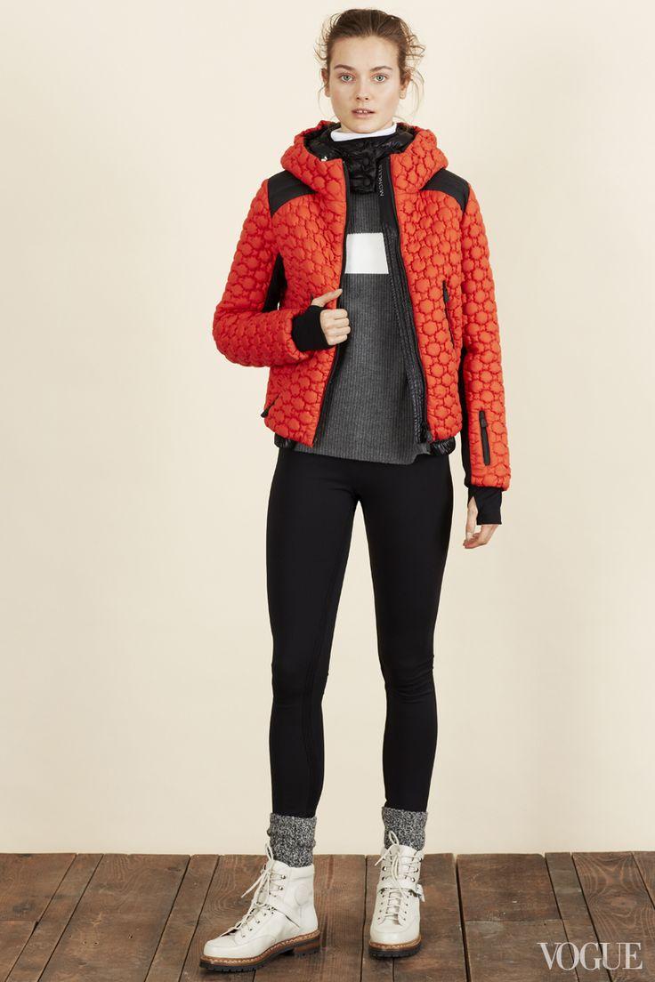 Jac Jagaciak in a Moncler jacket, T by Alexander Wang top, Hérve Léger pants, Wigwam socks, and Hermès boots