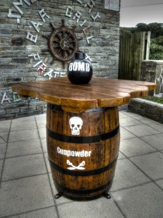 Bomb table (Smuggler's Bar and Grill restaurant indoor children's play area pirate themed with climbing ropes and slide)