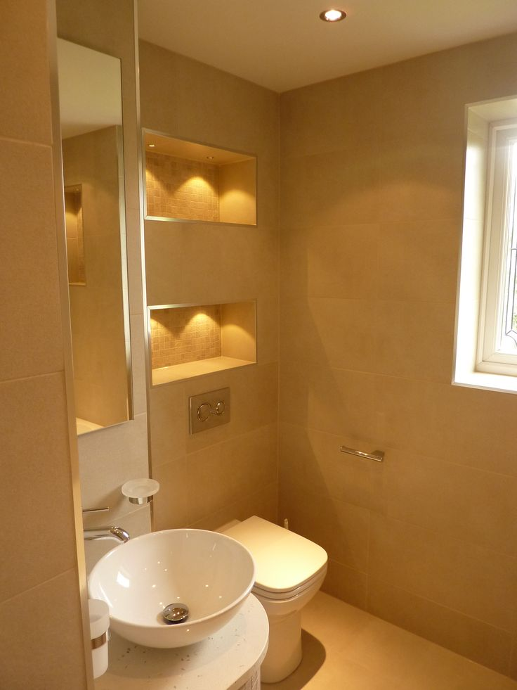contemporary cloakroom / powder room with back to wall pan toilet with concealed cistern and vessel counter top basin