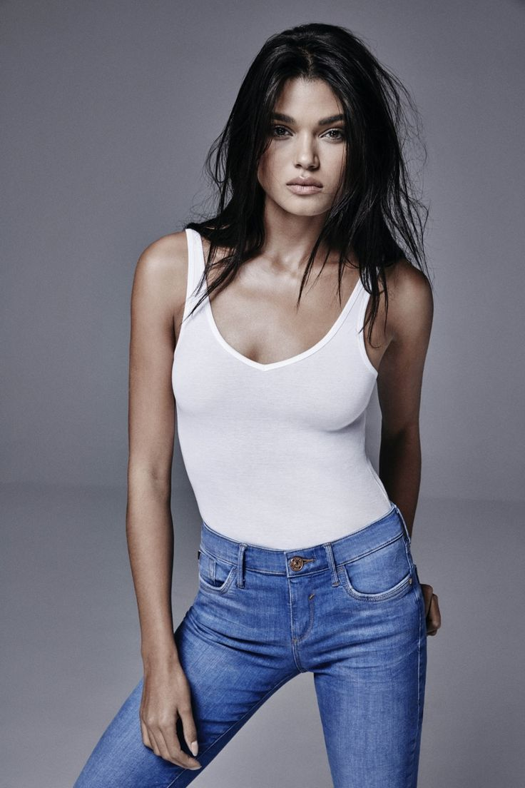Daniela Braga, Brazilian model  for RIVER ISLAND Spring 2016 Denim Campaign wearing a white tank and jeans | via www.orientsystem.com
