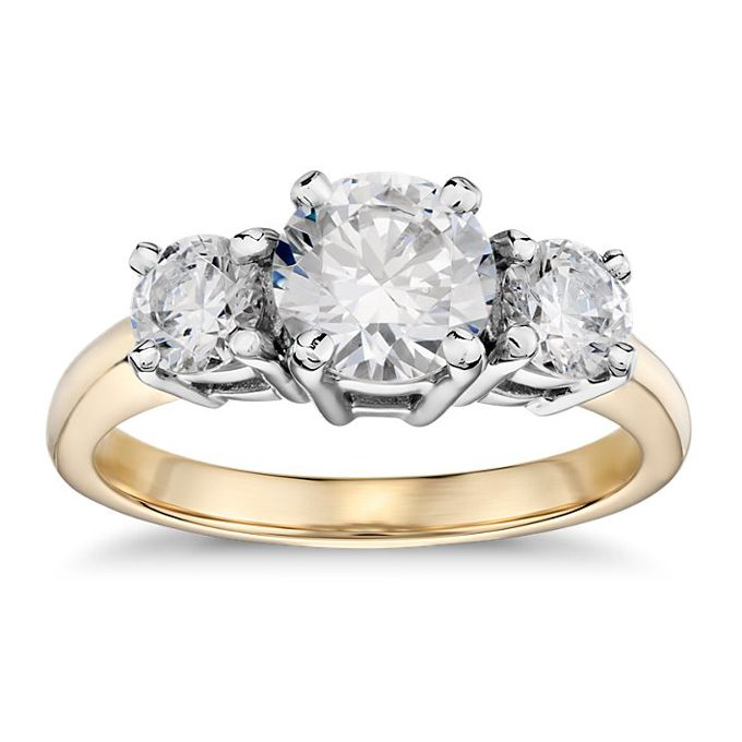 Brides.com: . Style 5924, three stone diamond engagement ring in 18K yellow gold, $750 (center stone not included), Blue Nile  See more Blue Nile engagement rings.