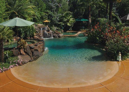 This tropical beach entry pool has the look and feel of a private beach resort how can you get - Beach entry swimming pool designs ...