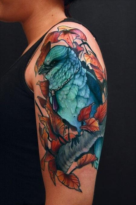 Half-Sleeve tattoo, bird and leaves. Vibrant colors | Daniel Gensch.