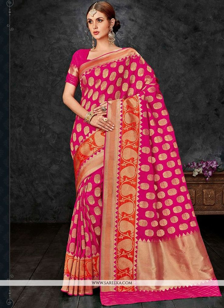You will be the center of attention in this attire. Add a small burst of colour to the wardrobe with this hot pink banarasi silk traditional  saree. The weaving work appears chic and fantastic for any...