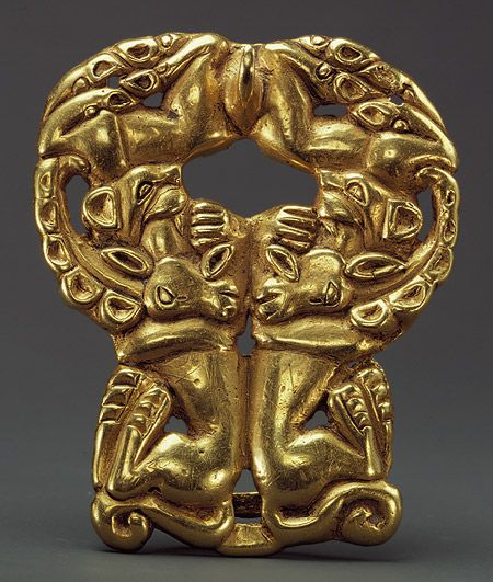 Belt buckle: paired felines attacking ibexes, Xiongnu type, 3rd–2nd century B.C.  Gold