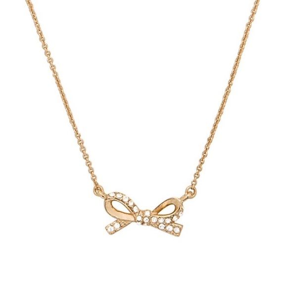 "Kate Spade Skinny Mini Pave Bow Necklace Kate Spade skinny mini pave bow necklace. 12 karat gold plated metal with cubic zirconia and glass. Lobster claw closure. 15"" long with 3"" extender. Bracelet and earrings sold separately. kate spade Jewelry Necklaces"