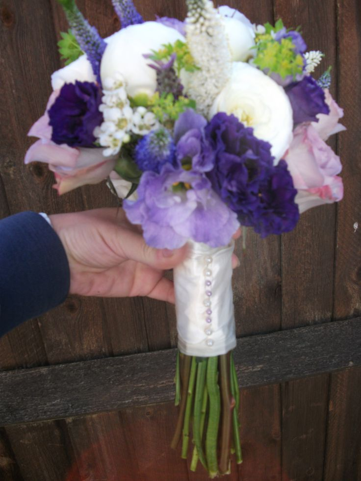 soft coloured bouquet of peonies, lisianthus, veronica, roses, and buplerum