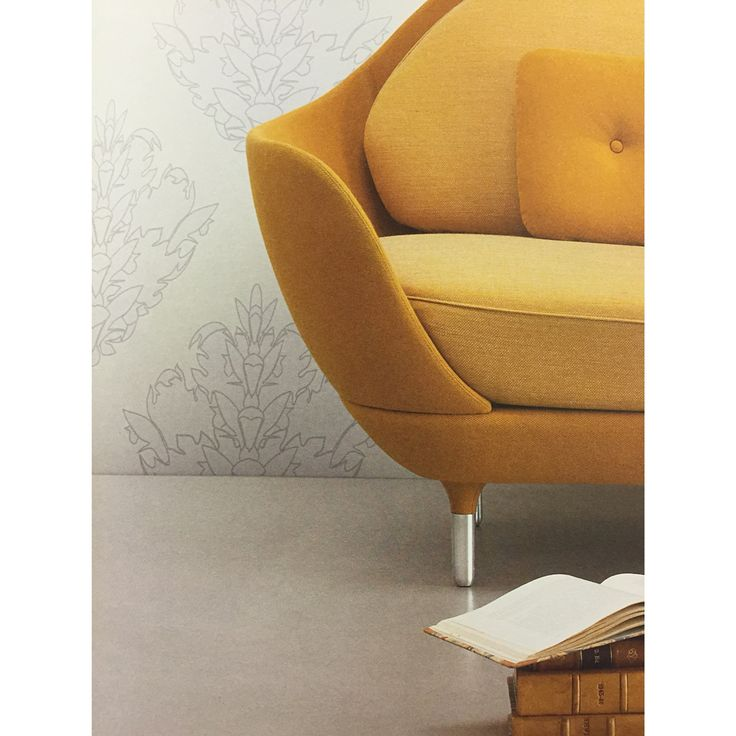 Just love the yellow chair with the white wallpaper
