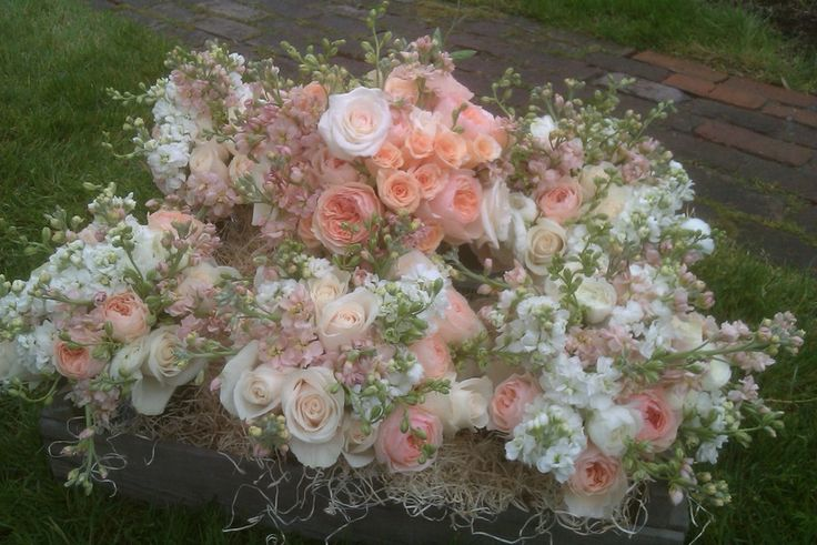 The roses for Megan's big day were: David Austin 'Juliet', 'Vendela', and 'Surprise' (from PeterKort). Peach and white Stock, Ranunculus, Larkspur and Sweet Peas rounded out the spring-y bridesmaid's bouquets