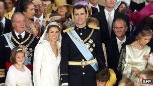 File photo: Spanish Crown Prince Felipe of Spain (C-R) his wife Princess of Asturias Letizia Ortiz and King Juan Carlos of Spain (third row,...