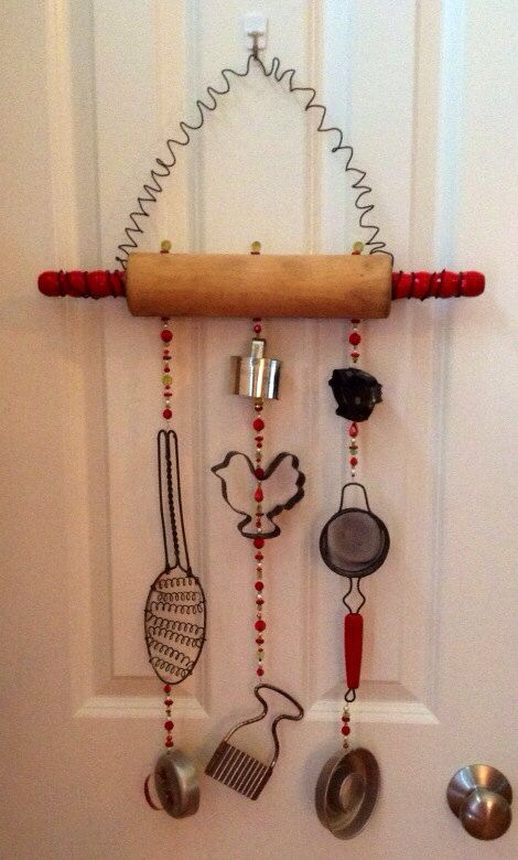 Repurposed vintage rolling pin and kitchen misc. wind chime via Etsy