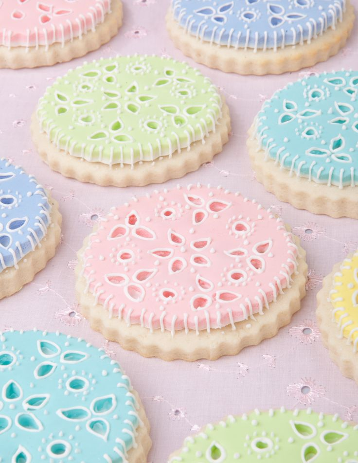Very pretty eyelet cookies made with fondant. Love the soft colors.  Put a very thin second layer under of a different color to show through the eyelet.  Pretty!