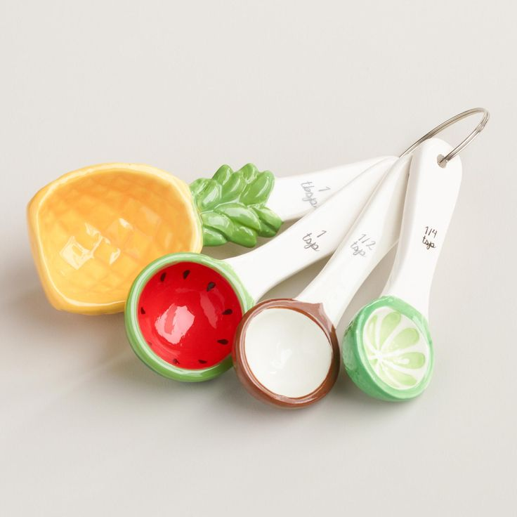 Featuring your favorite tropical fruit in vivid colors, our exclusive ceramic measuring spoons nest for easy storage and look great on the countertop. www.worldmarket #WorldMarket Home Decor