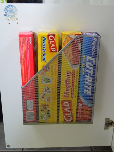 Get plastic wrap and aluminum foil out of the way by stowing them in a well-hidden magazine file.
