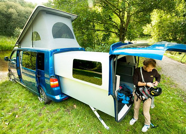 """Due to a stupid import tariff known as the """"chicken tax"""", the newest VW camper van you can get in the U.S. is a 2003. If you're lucky enough to find one this incredible slide-out camper conversion unit called the Doubleback will expand your Transporter into a full-fledged RV."""