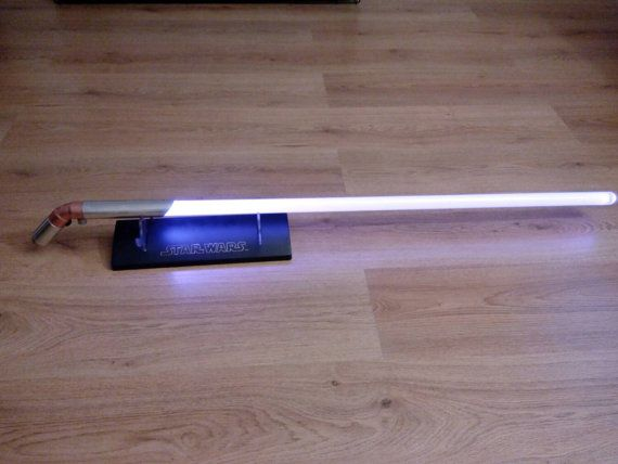 Hey, I found this really awesome Etsy listing at https://www.etsy.com/uk/listing/253453418/curved-lightsaber-hilt