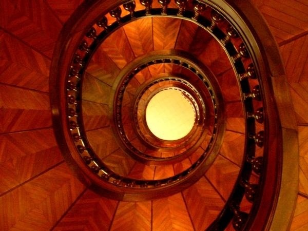 Looking up the spiral staircase at the Grand Hotel Moderne, in Lourdes, France.