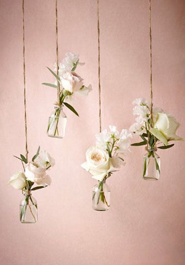 "With these petite hanging glass vases, a forest fete can positively burst with tiny blooms. Set of 4, 3.5""H, 0.5""D, Glass, jute string, Imported."