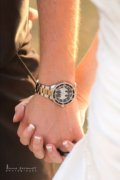 This groom chose to include Batman in a more subtle way — on the face of his watch.