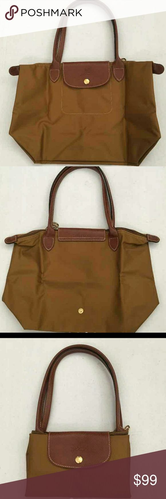 "Authentic long champ bag. NWOT.  Approx Size: 14.5""x10""x5.5 Longchamp Bags"