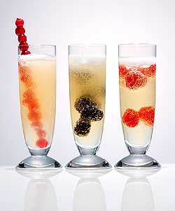 Limoncello Cocktails: Ingredients;  4 ounces champagne 1 ounce limoncello, 1 tablespoon fresh blackberries, currants or raspberries, Crushed ice. Preparation:  In a mixing glass, combine sparkling wine and limoncello. Place a spoonful of crushed ice in a Champagne flute and top with raspberries, blackberries or currants. Pour the sparkling limoncello mixture over the berries and ice.