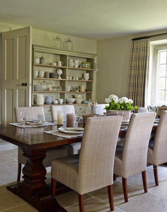 Traditional Dining Room With Painted Dresser