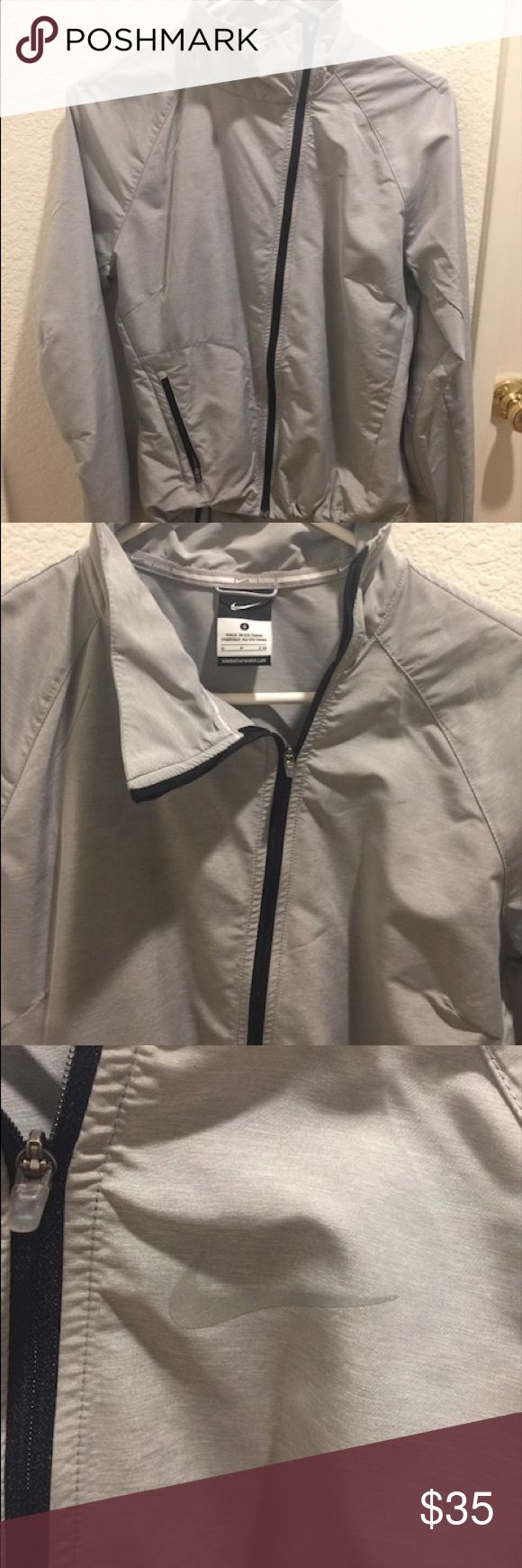 Nike running jacket Light weight grey Nike running jacket. Very thin and waterproof in the rain. Nike Jackets & Coats