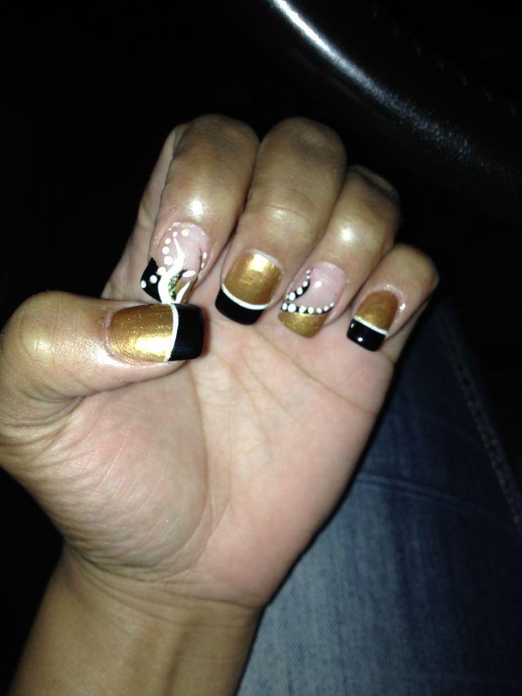 Gold/black New Orleans saints inspired nail art