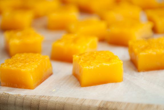Passion Fruit Mochi: 1 1/2 cups sugar 2 cups (8.25 oz or 240 g) mochiko (glutinous rice flour) 2 cups passion fruit juice 1 cup cornstarch Preheat oven to 350°F. Grease a 9- x 9-inch baking pan. Combine the sugar, glutinous rice flour, and passion fruit juice and mix until smooth. Pour batter into the baking pan and bake for 1 hour. Remove from oven and let cool. Cut mochi into pieces and dust with cornstarch to prevent sticking.