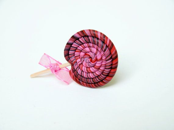 Polymer clay lollipop ring with pink bow by PieceOfCakeHJ on Etsy, €6.00