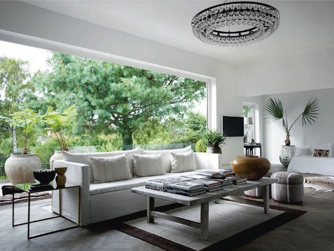 Contemporary sitting room with large white sofa and ochre light French By Design: House Tour : At home with Lars + Camilla + 2