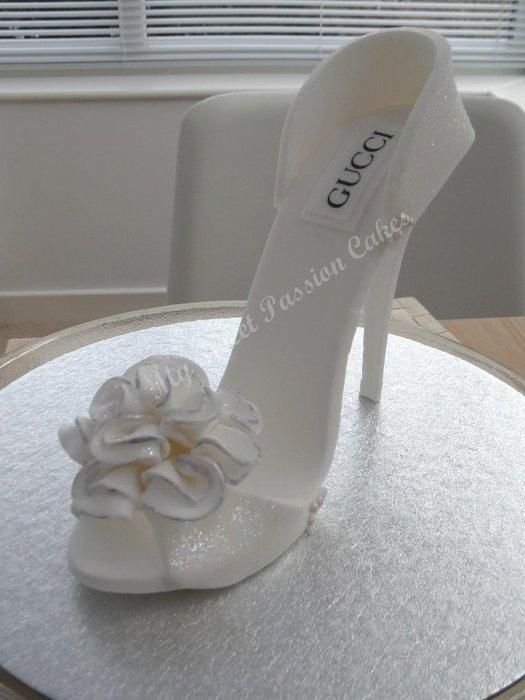 Edible shoe ;) hope you like it. Wedding is next month- just made size 6 shoe topper.
