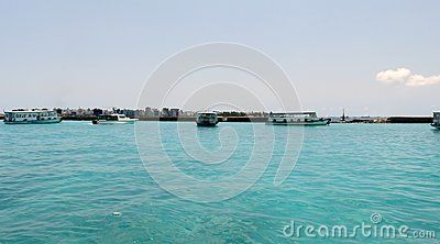 Water and boats at the port of Velana International Airport, in Maldives.