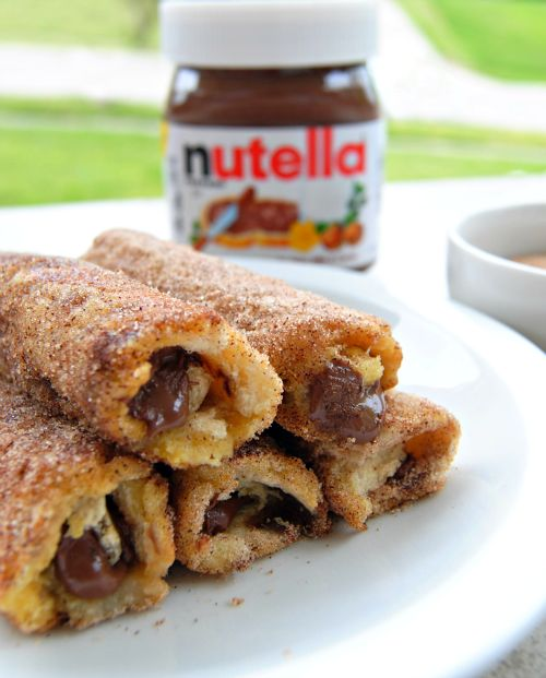 Made this for my kids this AM.....oh. My. Goodness! Nutella French Toast Rolls…