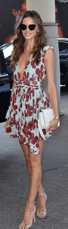 Who made Izabel Goulart's white handbag, tan crystal sandals, and blue floral dress?