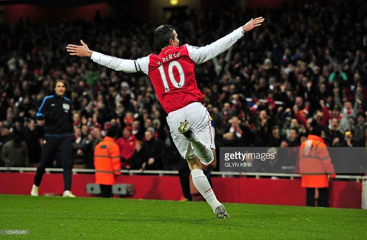 """Arsenal's Dutch striker Robin Van Persie celebrates scoring his goal during the English Premier League football match between Arsenal and Everton at The Emirates Stadium in north London, England on December 10, 2011. USE. No use with unauthorized audio, video, data, fixture lists, club/league logos or """"live"""" services. Online in-match use limited to 45 images, no video emulation. No use in betting, games or single club/league/player publications."""