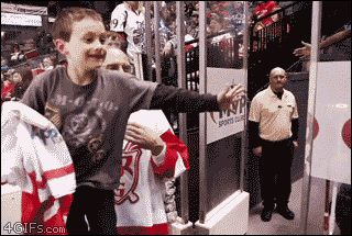 This ice hockey player making this kid's YEAR.   Community Post: 28 GIFs To Make You Happy When You're Feeling Down