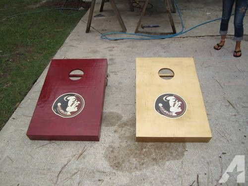 Two FSU Cornhole Game Boards, Handmade solid wood with bean bags. We also make custom ones if you happen to not be a FSU fan. If interested call if no answer leave message & I will return your call. Also can call  Since they are made to order it will take 7 days from the placement of order to the time you will recieve.