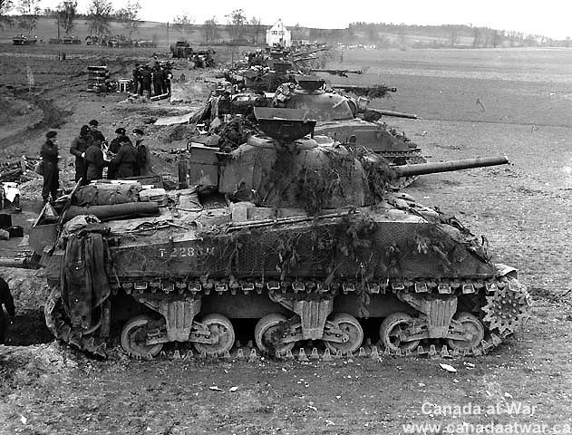 Canadians in Germany - Sherman tanks of the 4th Armoured Division ready to advance near Sonsbeck, Germany, March 9th,1945.