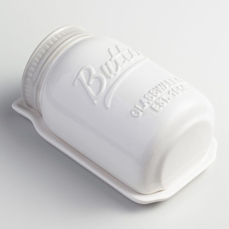 Crafted of white ceramic with a vintage-style embossed design, our exclusive butter dish is a great addition to your mason jar collection. It keeps your butter or margarine fresh and spreadable and your table setting chic and charming.  www.worldmarket.com #WorldMarket Mason Jar Shop