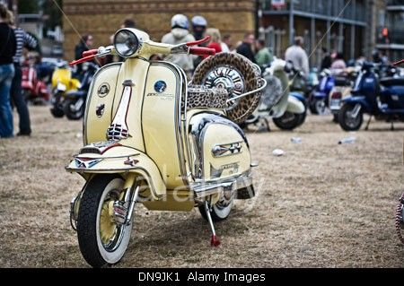 A Yellow Lambretta TV175 is displayed on Ryde Common during the Isle Of Wight Rally 2009.